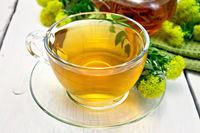 Tea of Rhodiola rosea in cup on light board