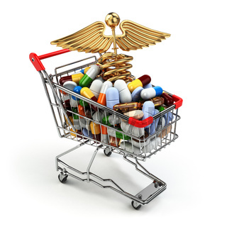 Pharmacy medicine concept. Shopping cart with pills and caduceus symbol.