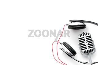 vintage silver microphone and headphones