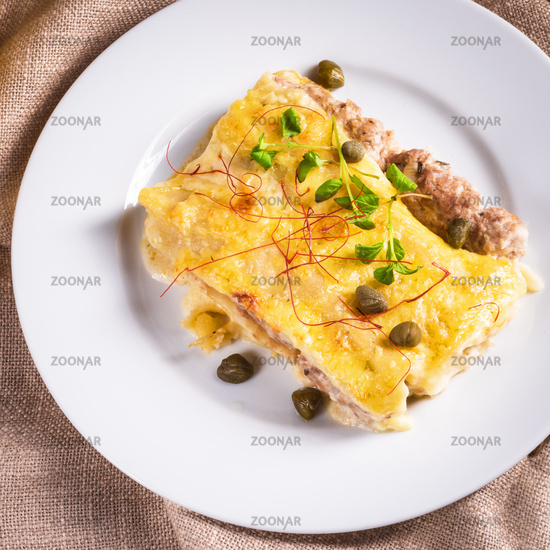 Cannelloni with mince filling and capers