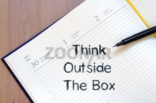 Think outside the box write on notebook