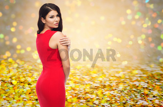 beautiful sexy woman in red dress over glitter