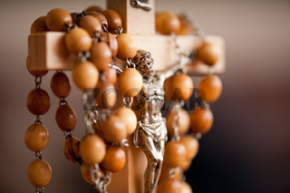 Wood rosary and Jesus figurine