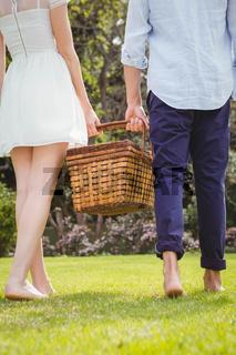 Young couple walking in garden