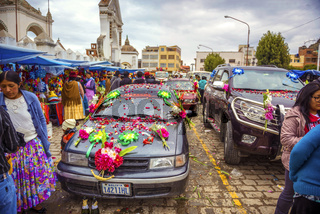COPACABANA, BOLIVIA - JANUARY 3: unidentified cars outside the basilica of the Virgen de la Candelaria for the weekend blessing of automobiles January 03, 2014 in Copacabana, Bolivia, South America