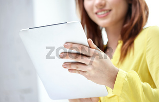 close up of female hands with tablet pc