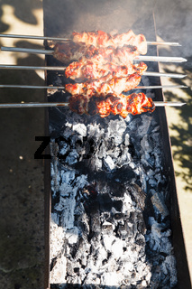 kebab sticks on outdoor grill