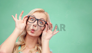 happy young woman in glasses making fish face