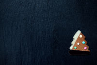 Gingerbread Christmas tree on black with space for text
