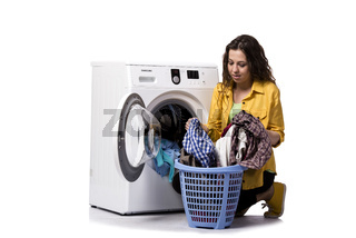 The young woman doing dirty laundry isolated on white