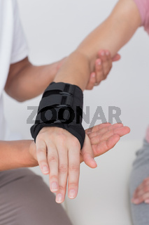 Doctor examining a woman wrist