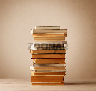 A stack of books with vintage background