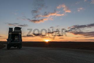 Off-road vehicle oldtimer sunset