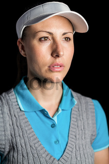 Golf player on black background