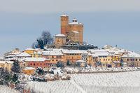 Small town on snowy hill in Italy.