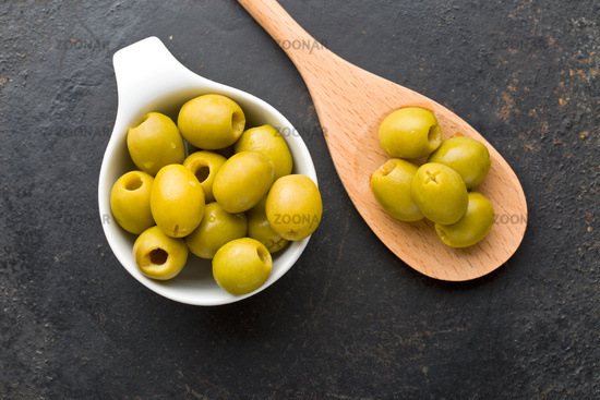 pitted green olives in bowl