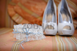 wedding accessories and bridal shoes on the table