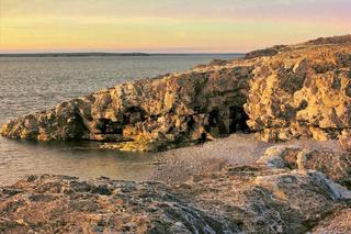 Beautiful cape in strait between islands of the Arctic