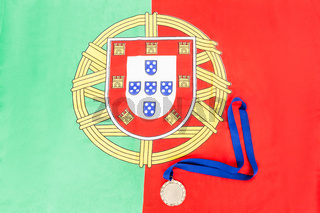 Gold medal on portuguese flag