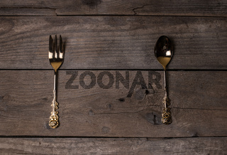 vintage forks and spoons on old wooden boards