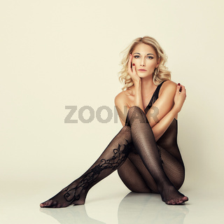 sexy attractive girl in stockings pose on floor