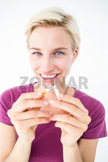 Pretty blonde breaking cigarette