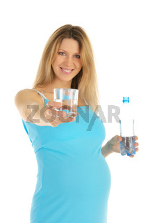 pregnant woman holds out glass of water