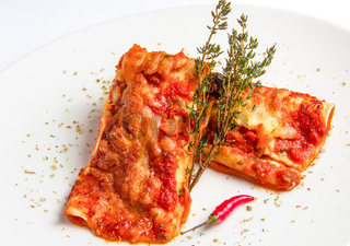 Mexican chicken enchiladas with spicy tomato sauce and cheese.