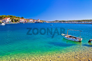 Boat on Turquoise beach in Rogoznica