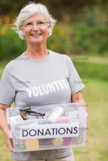 Happy grandmother holding donation box