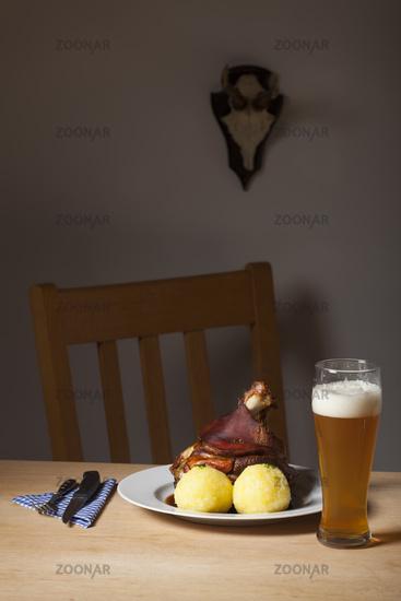 Bavarian knuckle of pork on a table