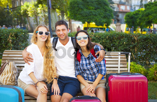 Travelers friends with luggage in the city