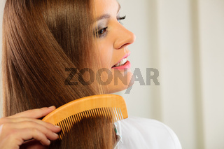 beautiful woman with long hair and comb