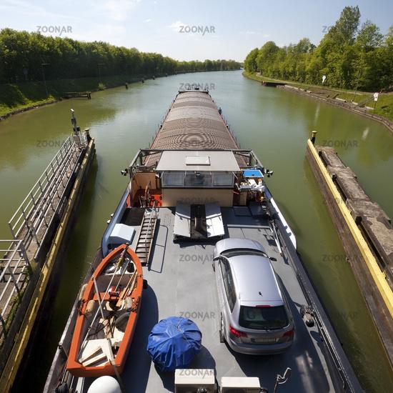 barge leaving the lock Bevergern, Dortmund Ems Canal, Hoerstel, North Rhine-Westphalia, Germany