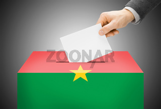 Voting concept - Ballot box painted into national flag colors - Burkina Faso