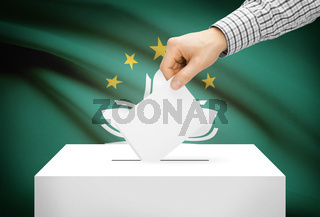 Voting concept - Ballot box with national flag on background - Macau
