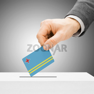 Voting concept - Male inserting flag into ballot box - Aruba