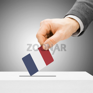Voting concept - Male inserting flag into ballot box - France
