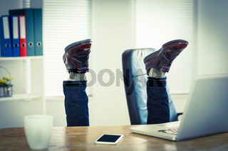Businessman upside down at his desk