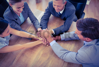 Business people joining hands in a circle