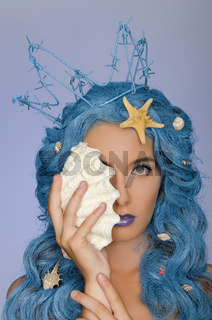 Portrait of woman with blue hair, shells and crown