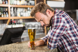 Tired man having a beer