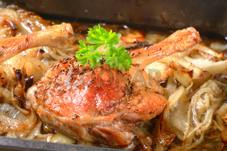 Roast duck legs with caraway and onion