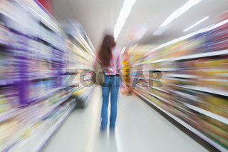 Rear view of woman standing in aisle with blurred effects