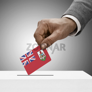 Black male holding flag. Voting concept - Bermuda