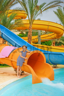 little girl near water park slides