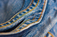 Jeans with yellow stitching thread