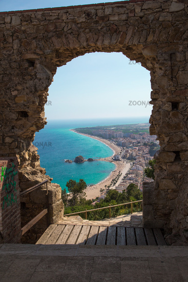 Costa Brava, overlooking the beach through the hole in a ruin