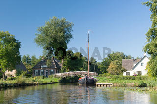 With boat in Dutch village