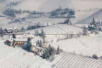Rural houses on snowy hills.